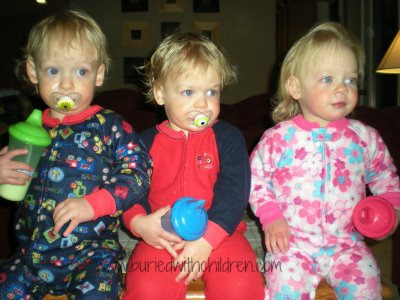 toddler triplets with sippy cups